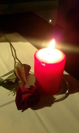 The Excelsior Bistro: rose, candle