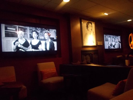 The Garland: The lounge and bar with black and white film clips of Beverly Garland