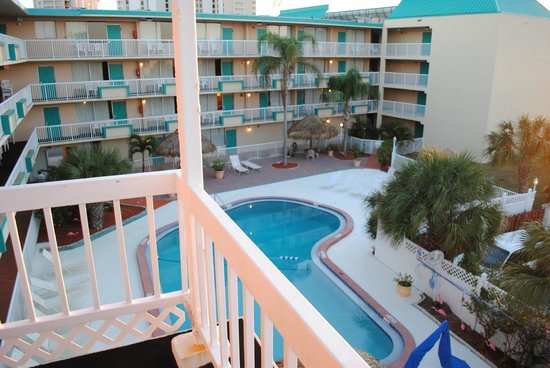Magnuson Hotel Clearwater Beach : view of pool from third/fourth floor stairs balcony.