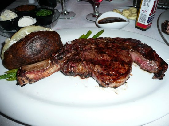 The Steak House: My bone-in-rib-eye steak with baked potato