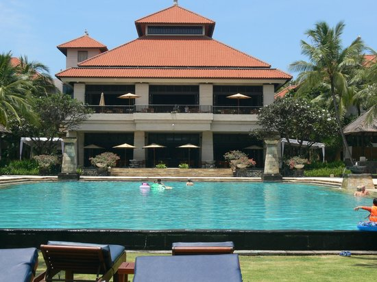 Conrad Bali: Main pool with dining area in background