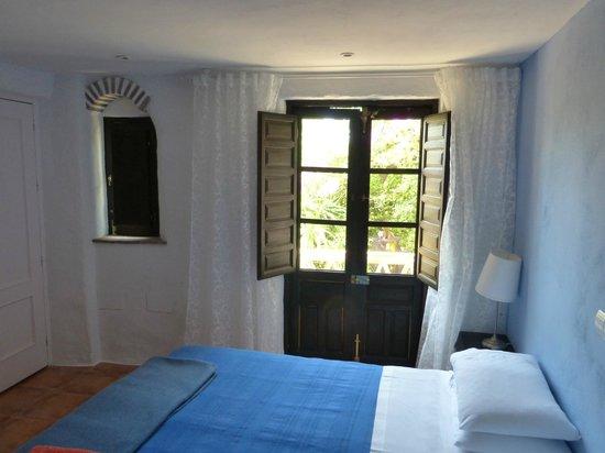 Hotel Finca el Cerrillo: bedroom with view into gardens