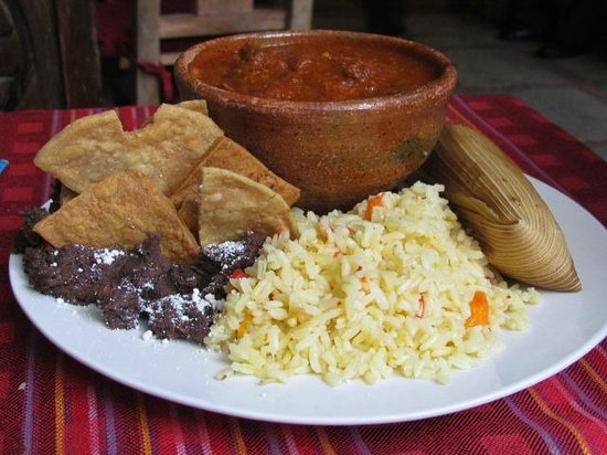 La Cuevita de Urquizu: a meal with fried beans, rice, a tamal and mixed beef in sauce
