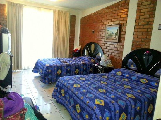 Mariana's Petit Hotel: Habitación