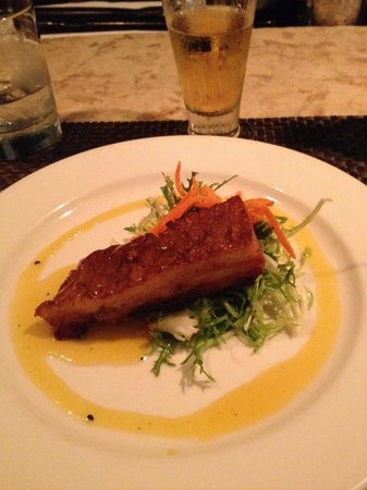 Waterfront Bistro: Pork belly over dried mangos and frisée.