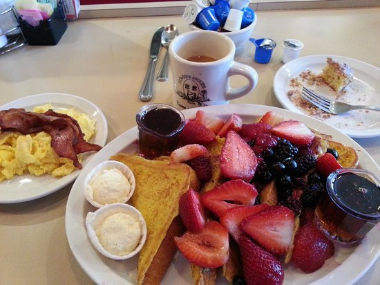 Mo's Egg House: French toast and berries plater, eggs and bacon included