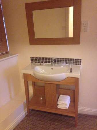 Guy's Thatched Hamlet: The sink area in the standard room.