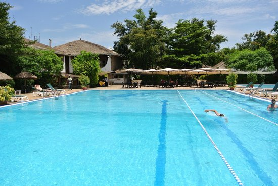 Hotel Club du Lac Tanganyika : Hotel pool on a sunny afternoon with view of the outdoor dining area