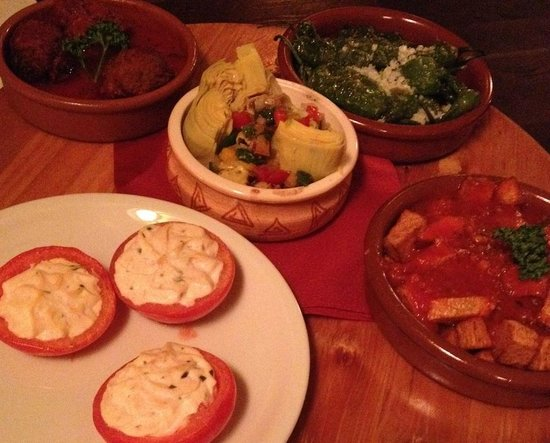 La Tasca: The tapas come on a round wooden board which you can turn. Mmmmh!!!