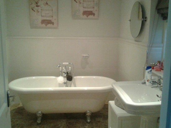 The Swan Motel: Free standing roll sided Victorian style bath .