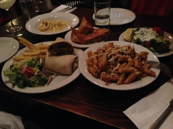 Premises Cafe: Burritos, Seafood Penne, Spinach triangles and more...