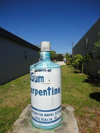 Murals of Lake Placid: Turpentine bottle trashcan