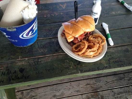 Loco Coyote Grill: That is a regular size beer bottle next to that brisket sandwich!