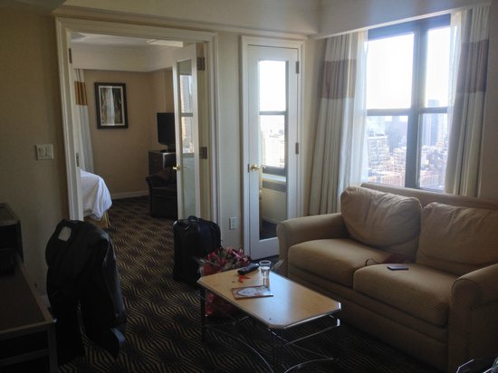 The New Yorker A Wyndham Hotel: Tower Suite Sitting Area Into Bedroom