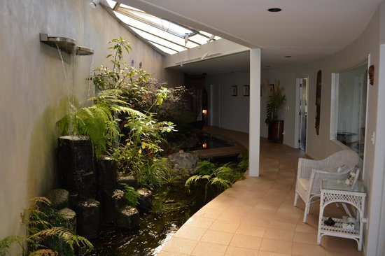 Moon Gate Villa : Entry with garden, koi pond and waterfall