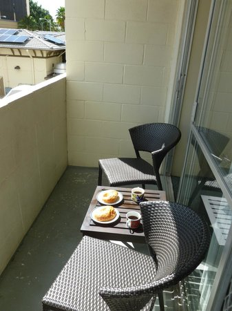 """Waikiki Central Hotel: """"Balcony"""" coffee and dishware included (croissant not included)"""