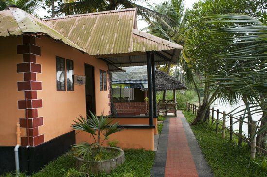 Mangrove Island Village Private Tours: LAKE FACING ISLAND COTTAGE