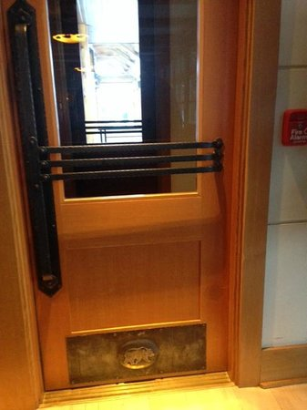 Old Faithful Snow Lodge and Cabins : Brass Bison detail on door