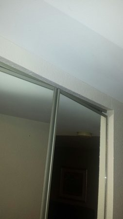 Hampton Inn & Suites Nashville / Airport : None to the closets in the suite worked or even closed.