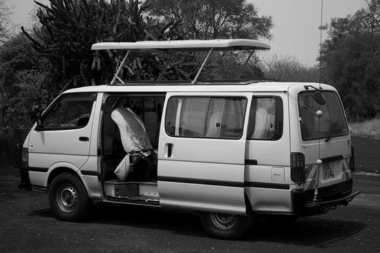 Natural World Kenya Safaris: Van we traveled in with the top popped up.