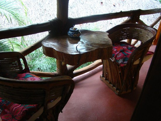 Holbox Hotel Mawimbi : Our balcony table beside the two hammocks