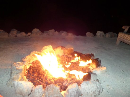 The Dining Room at Little Palm Island: Fire pit at night