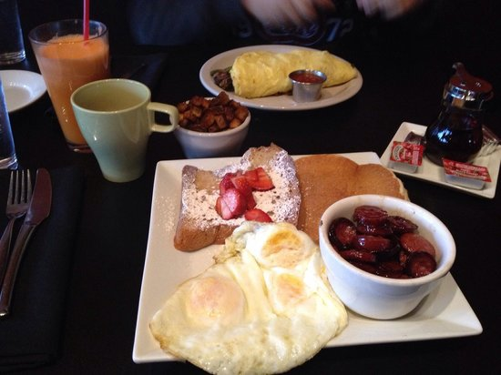 Kozy Kitchen: Front: The B, with a side order of papas and coffee. Back: Steak Omelette with fresh carrot-oran