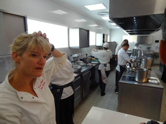 The Tasting Room: Margot Janse - hard at work! Notice the induction hubs - no more searing heat in the kitchen!