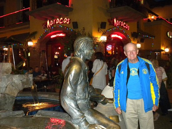 My husband by the Sonny Bono Fountain with the Maracas cafe in the background