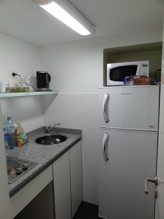 Art Suites: A cozinha é pequena mas funcional