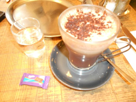 Kipferl: Coffee served with water and a chocolate