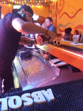 !Orale Guey!: Bartender making fancy layered shots.