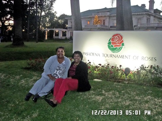 Tournament of Roses Association: Angela and me in front of the house sign