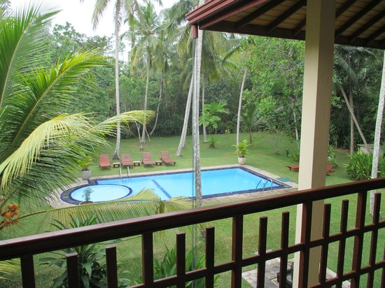 Suhada Villa: view from balcony over looking pool and garden