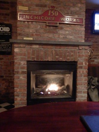 Fitzpatrick Grand Central Hotel: Fireplace in the pub