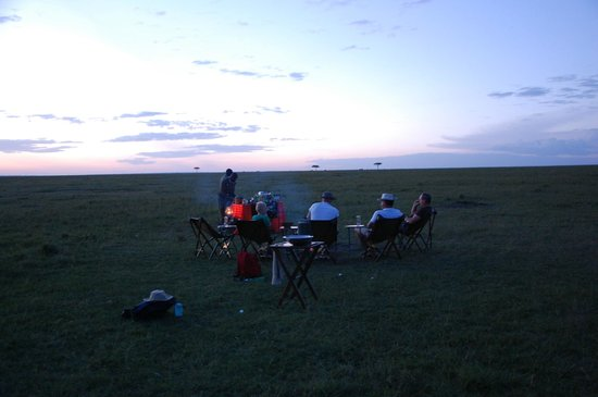 Elephant Pepper Camp: After the Funwalk, campfire and drinks on the Masai Mara