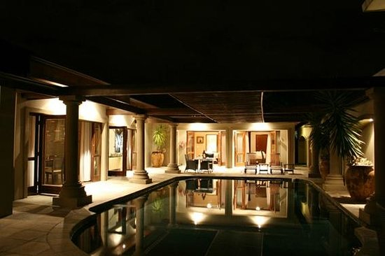 Manor 38: Night view of pool area