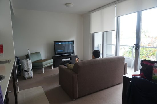 Cairns Luxury Apartments - Harbourlights complex : Living room in One-Bedroom Garden View