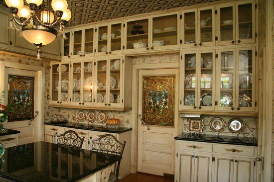 Kitchen has floor-to-ceiling cabinets and imported stained glass ...