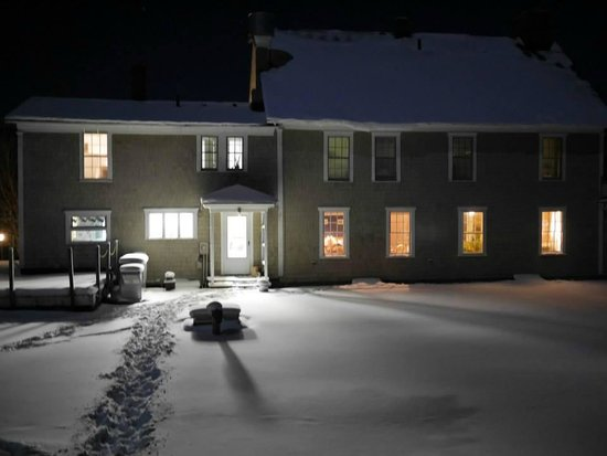 Seyon Lodge : The back of the lodge on a cozy winter night.