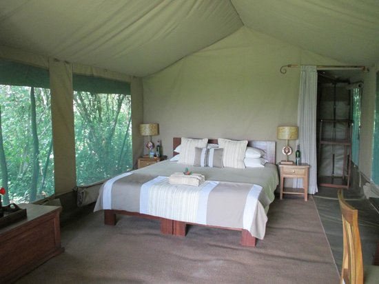 Rekero Camp, Asilia Africa: What a bedroom :-) very comfy bed too