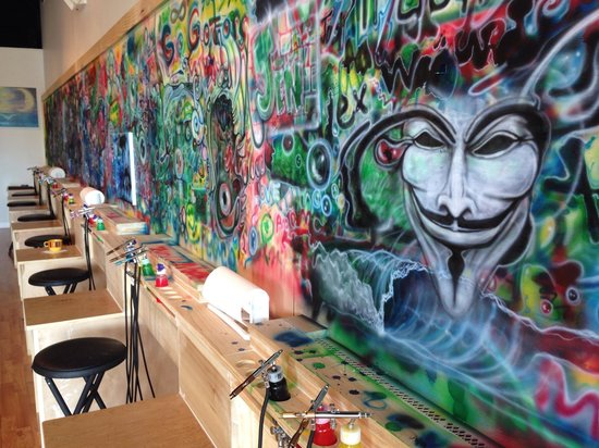Blast Studios: Airbrush art on 45ft wall