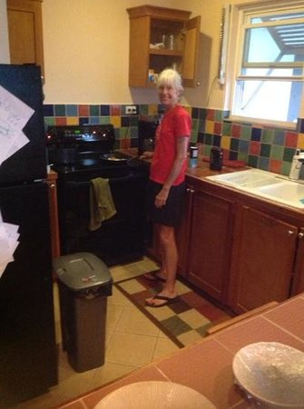 Dee N' D's : my wife at her stove at caye reef
