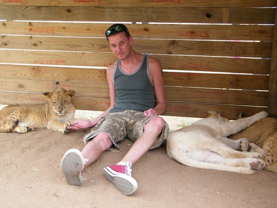 Lion and Safari Park: Me sitting with the cubs.