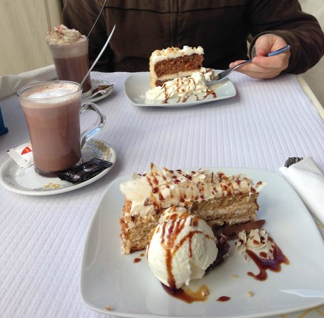 The Oasis: Hot Drink and Cake (with cream or ice cream) deal!