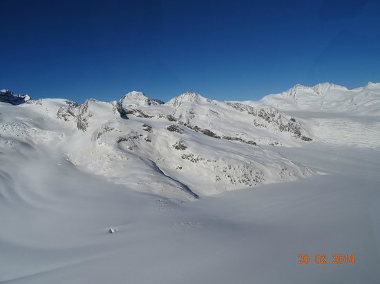 Schilthorn: AWESOME AERIAL VIEW ON MOUNTAINS AS SEEN FROM OUR HELICOPTER ROBINSON R-44 CLIPPER II, FEB 2014.