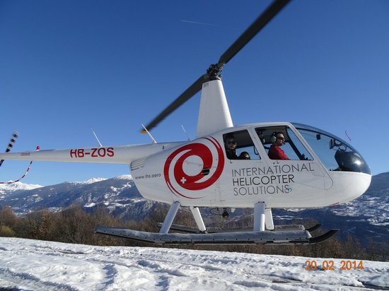 360° Restaurant Piz Gloria: BACK FROM SCHILTHORN, AWESOME AERIAL VIEW ON OUR HELICOPTER ROBINSON R-44 CLIPPER II, FEB 2014.