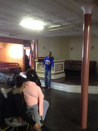 First African Baptist Church: Tour guide Johnny showing us the floor where the Underground Railroad exist.