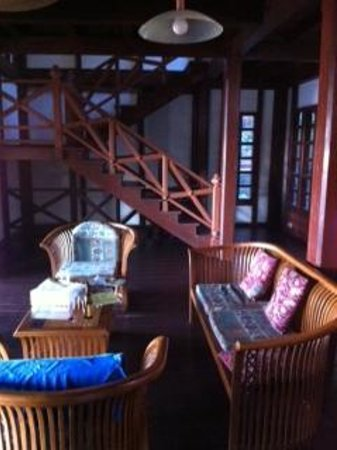 Sari Village Holiday Homes: ground floor living room, seating with incomplete cushions, stair leading to upstair