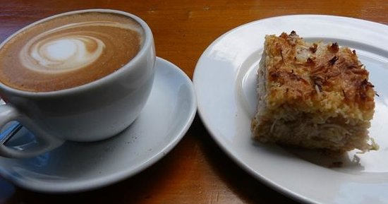 Hislops Wholefood Cafe: Flat white and rhubarb, apple, coconut crumble!